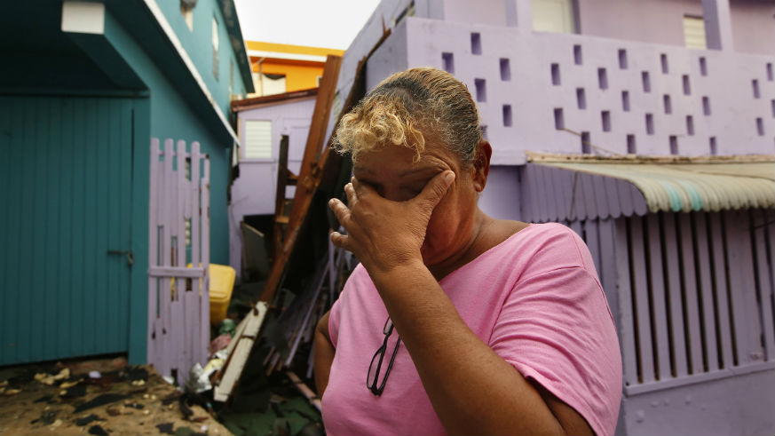 A Hurricane Maria survivor weeps amid the storm's destruction.