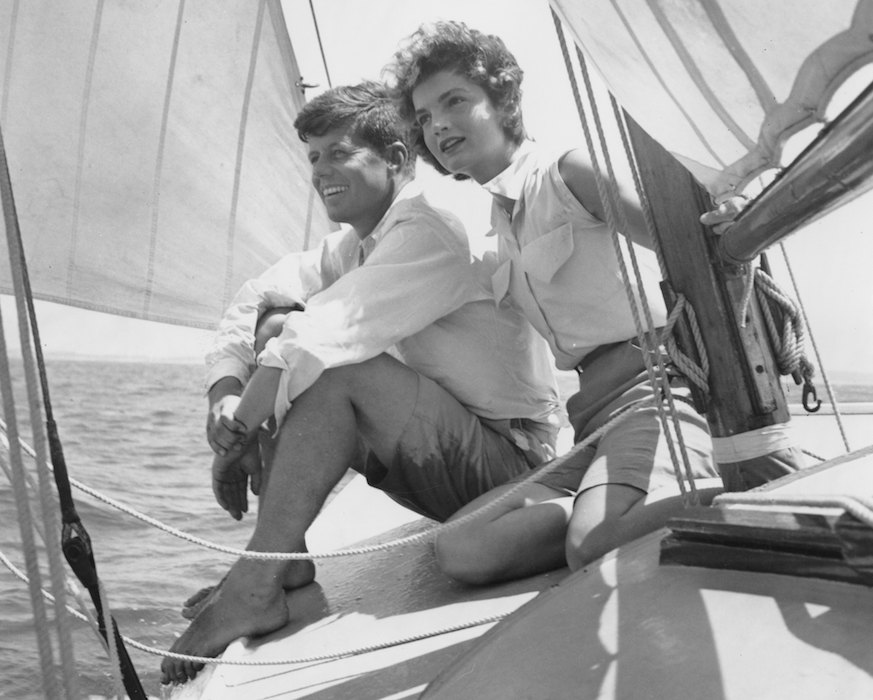 John F. Kennedy and Jacqueline Bouvier sailing, 1953 Photo: Hy Peskin Archive
