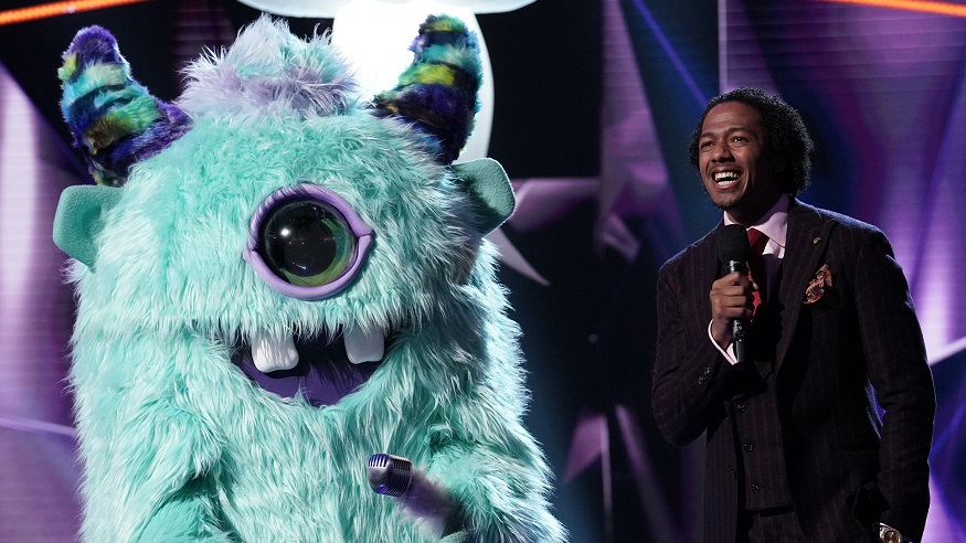 The Masked Singer host Nick Cannon poses with Monster