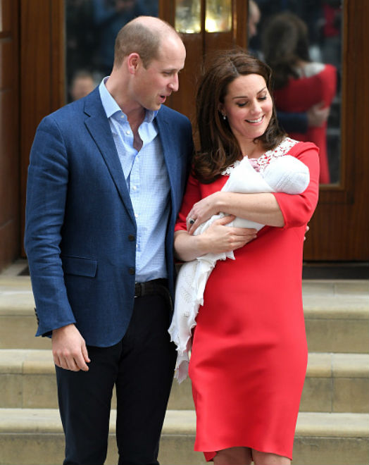 new parents posing for royal photos